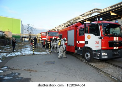 Rescue team training of chemical decontamination: rescuers in protective ensembles preparing equipment to water plant territory. February 21, 2019. Kiev, Ukraine