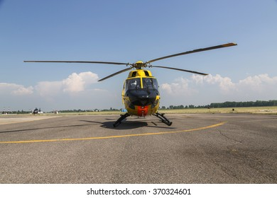 rescue yellow  helicopter on the ground in airport