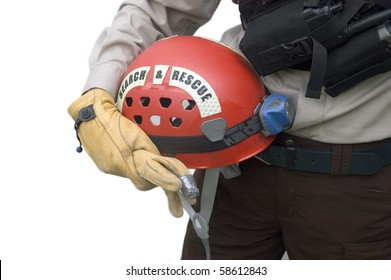 Rescuer holding leather gloves and a red helmet.