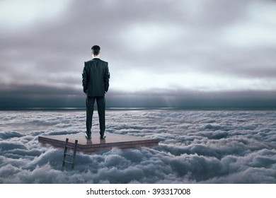 Research concept with man on brick pedestal in dull cloudy sky