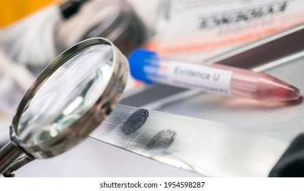 research with a magnifying glass footprint on a knife, conceptual image