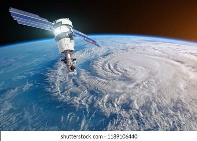 Research, probing, monitoring hurricane raging on the coast. Satellite above the Earth makes measurements of the weather parameters. Elements of this image furnished by NASA
