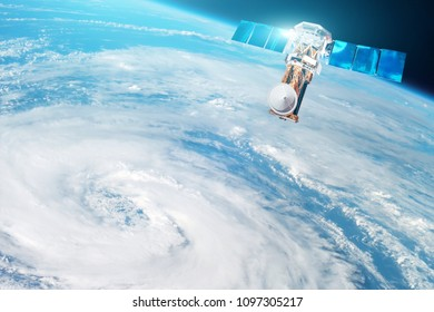 Research, probing, monitoring of tracking in a tropical storm zone, a hurricane. Satellite above the Earth makes measurements of the weather parameters. Elements of this image furnished by NASA