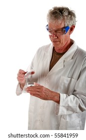 a research scientist examines a petri dish with a culture growing inside          isolated on white
