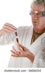 a research scientist examines a a test tube filled with blood  isolated on white
