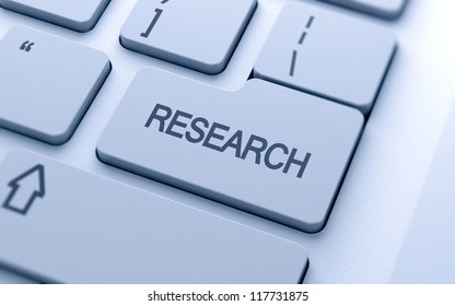 Research word button on keyboard with soft focus