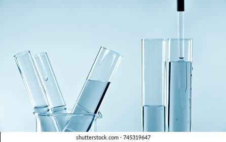 Researcher doing research and development in scientific laboratory, Scientist mixing chemical ingredients.