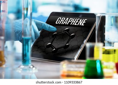 researcher working in the lab with screen computer and conceptual representation of graphene material / engineer working in the research laboratory with the tablet and symbol graphene in the screen