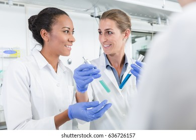 Researchers doing experiment in science lab