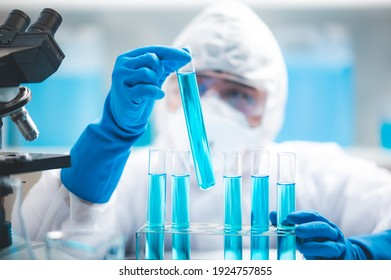 Researchers scientist working analysis with blue liquid test tube in the laboratory, chemistry science or medical biology experiment technology, pharmacy development solution