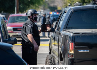 Reseda, California, United States - February 24, 2021:  LAPD Swat team, officers, and LAFD Firefighters and helicopters respond to a report of a gunman in a Reseda.  One suspect was taken into custody