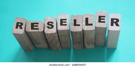RESELLER word made with building blocks. Trading reselling retail business concept.