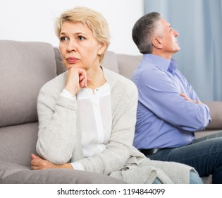 resentful middle-aged couple quarreling at home with each other and take offense