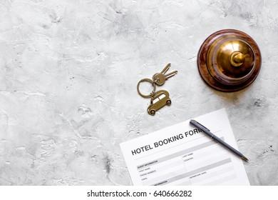reservation form on hotel reception desk background top view mock up