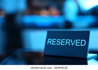 Reserved card sitting on a formal place setting