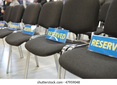 Reserved chairs in large conference hall