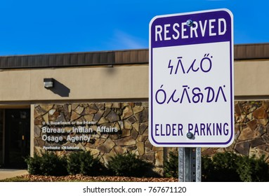 Reserved - Elder Parking sign in English and the Osage Indian Language (Wazhazhe) outside the Bureau of Indian Affairs Osage Agency in Pawhuska Oklahoma 11 - 30 - 2017