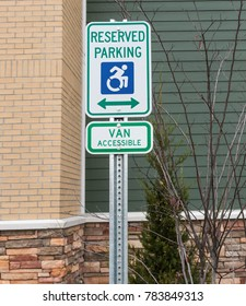 Reserved parking for handicapped that is van accessible in front of a hotel in upsate New York.