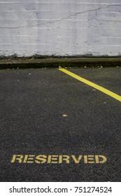 Reserved parking spot painted on the asphalt