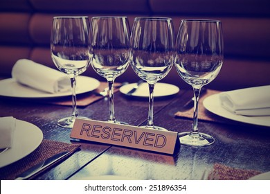 Reserved plate on an arranged restaurant table, toned image