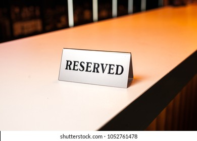 Reserved plate on bar, reserved sign.