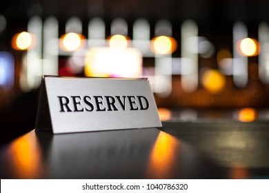 Reserved plate on night club, reserved sign.