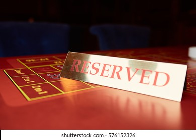Reserved plate on a table in a casino
