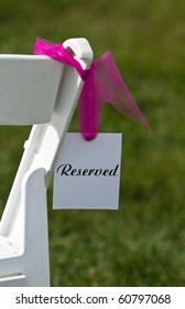 Reserved seat at an outdoor wedding ceremony