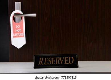 reserved sign at the hotel reception counter