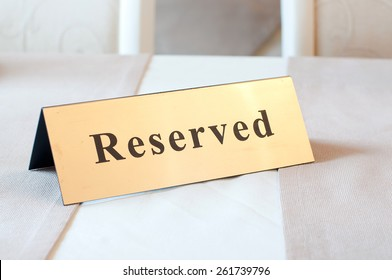 Reserved sign, reservation. On table. Beige