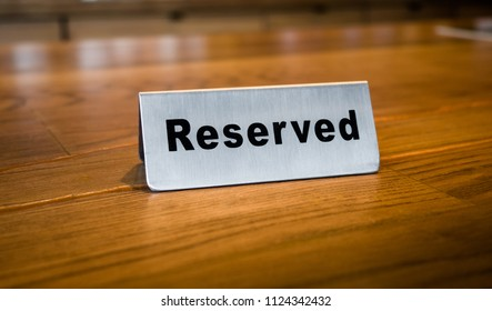 Reserved sign in restaurant.