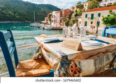 Reserved table in Greek tavern in Assos fishing village, Kefalonia island, Greece