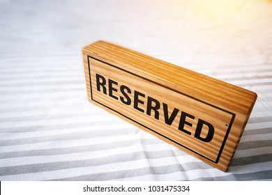 reserved table. reserved wooden sign on table for reservation placed. reserved table in the restaurant.