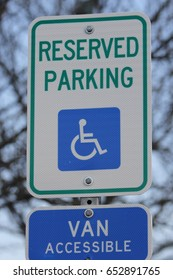 A Reserved Van Accessible Parking Sign with blue sky.