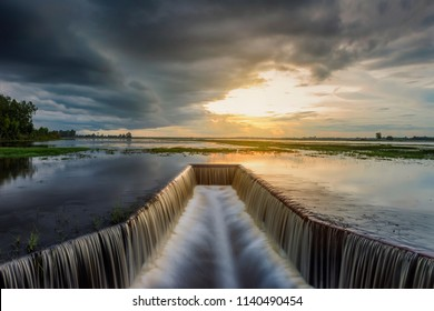 Reservoir with flowing water at sunset