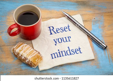 reset your minset advice - handwriting on a napkin with a cup of coffee and cookie
