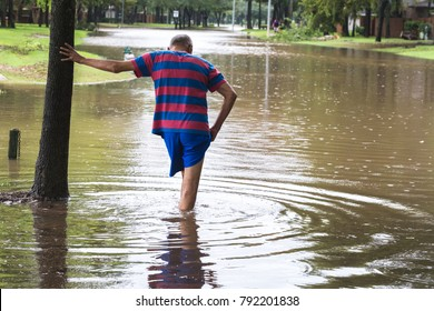 Resident of Houston suburb walk in high waters. Heavy rains from hurricane Harvey caused dangerous floods in many residential areas around Houston