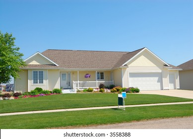 Residential American Ranch House - A residential suburban home in an upscale neighborhood in the summertime.