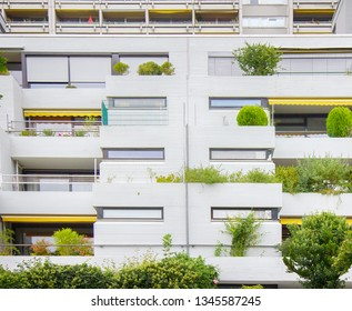 Residential apartment building with many terraces and a balcony with greenery as a micro-garden. Hanging Gardens of Babylon