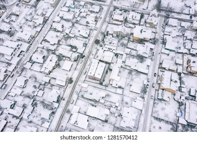 residential area in cold winter day. rooftops covered by snow. aerial view