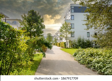 Residential area with ecological and sustainable green residential buildings, low-energy houses with apartments and green courtyard - Shutterstock ID 1867917709