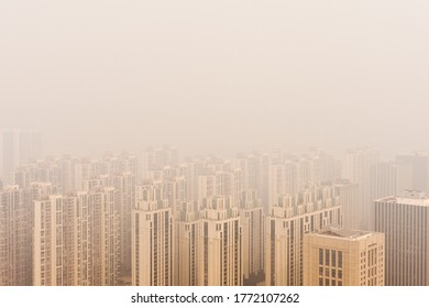 Residential area in Shijiazhuang, Hebei Province, China in the early afternoon hours with heavy smog and low visibility due to nearby industry activities