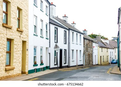 Residential area of terraced houses, neighborhood, houses in a row. Row of houses on street, townhouse, neighborhood house. Street row of house uk, rowhouse. English UK row of ?s
