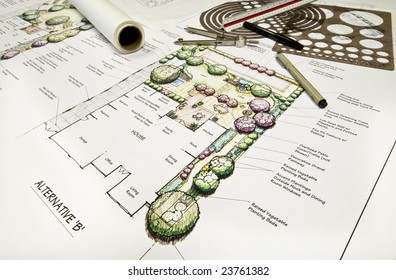 Residential back yard landscape design with drafting equipment.