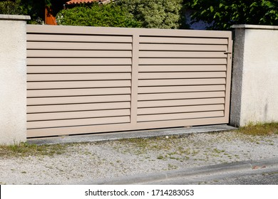 residential brown clear sand home suburb metal aluminum house gate street wall
