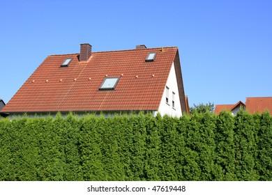 Residential building behind hedges