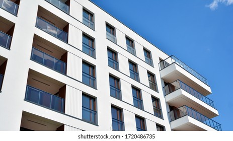 Residential Building on sky background. Facade of a modern housing construction with of balconies.