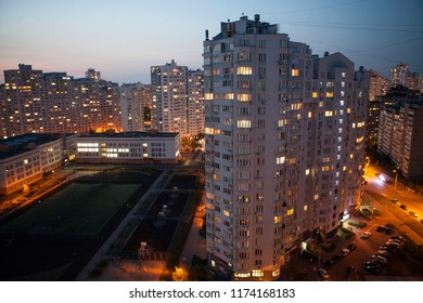Residential building and parking at night