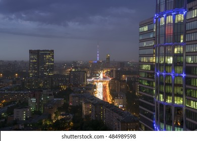 Residential buildings, big modern highway and roofs at summer night in Moscow, Russia, long exposure