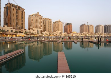 Residential buildings and empty Marina at The Pearl in Doha, Qatar